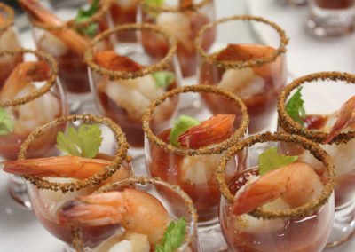 Mini shot glasses filled with shrimp and cocktail sauce